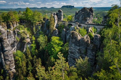Bridge named Bastei in Saxon Switzerland, at sunrise and the mist over the river Elbe, National park