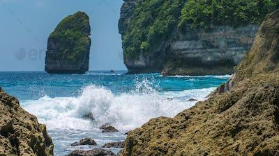Rock in Tembeling Coastline at Nusa Penida island, Ocean Waves in Front. Bali Indonesia