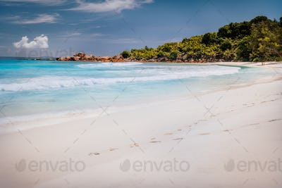 Beautiful anse cocos beach on sunny day at la digue island in Seychelles