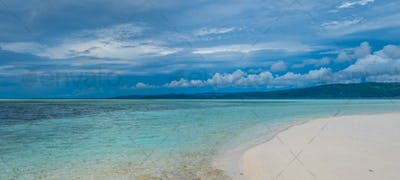 Sandy Bank on Kri Island, Low Tide, Gam in Background. Raja Ampat, Indonesia, West Papua