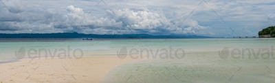 Sandy Bank on Kri Island, Low Tide, Gam in Background. Raja Ampat, Indonesia, West Papua