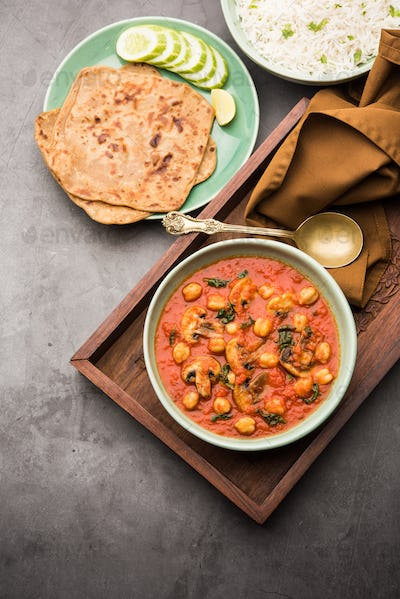 Indian Style Mushroom Chickpea curry in red sauce