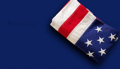 USA flag, US of America sign symbol on blue background, top view