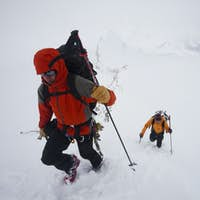 Two skiers ascend a slope on the Wapta Traverse, in Alberta, Canada.