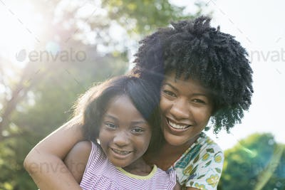 A young woman and a child hugging.