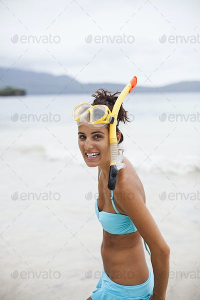 A young woman wearing snorkeling gear on the Samana Peninsula in the Dominican Republic.