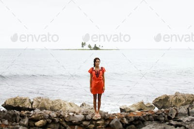 A woman on the beach on a cloudy day in Las Galeras, Samana Peninsula, Dominican Republic.