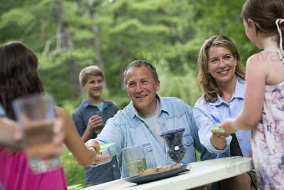 Organic Farm. An outdoor family party and picnic. Adults and children.