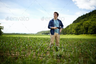 A farmer working in his fields in New York State, USA.