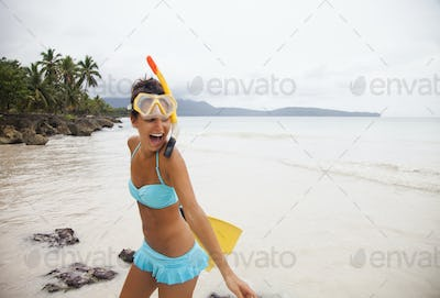 A young woman wearing a bikini on a secluded beach, Dominican Republic.