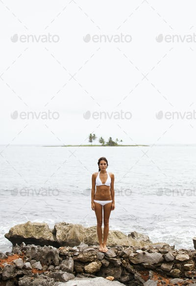 A young woman on the shore on a cloudy day in Las Galeras, Samana Peninsula, Dominican Republic.