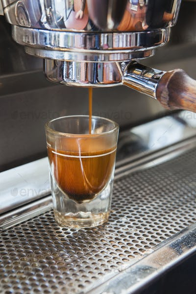 Espresso shot being poured from espresso machine, Seattle