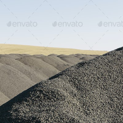 Gravel piles used for road maintenance and construction, a row of heaps near Pullman, Washington,USA