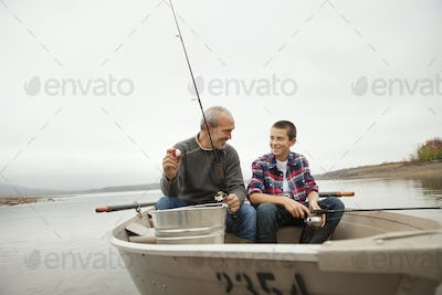 A day out at Ashokan lake. A man and a boy sitting fishing from the boat.