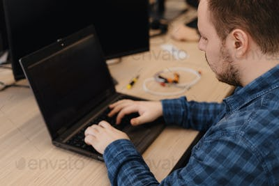 Programmer working on desktop pc programming code