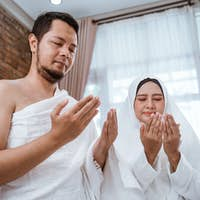 Muslim man and woman praying open arm
