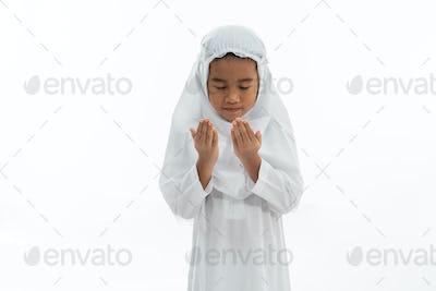 muslim kid praying isolated