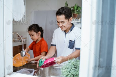 little Girl Help Her father In Washing Dishes