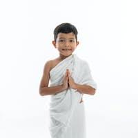 muslim kid with ihram smiling to camera