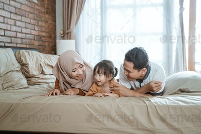 Muslim families are happy when reclining lying in bed
