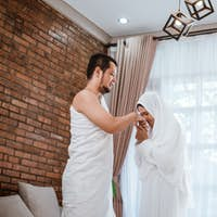 shake hand wife kiss husband's hand after praying