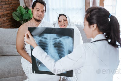 muslim looking at chest xray before going for hajj and umrah