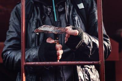 Drug addict smoking opium on tin foil