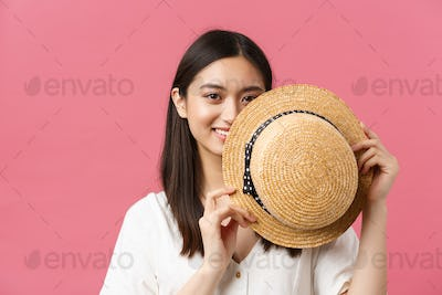 Beauty, people emotions and summer leisure concept. Close-up of shy and cute japanese girl cover
