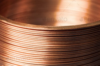 Close-up flat twisted copper wire at a factory