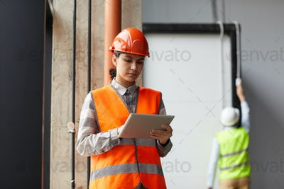 Construction worker using tablet pc