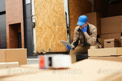 Delivery person using tablet pc