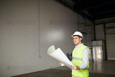 Engineer examining the plan