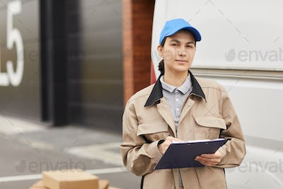 Woman working in delivery warehouse