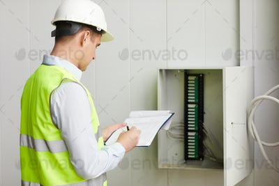 Engineer checking the data