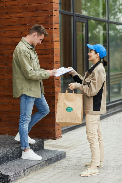 Man getting food delivery