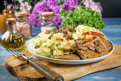 Braised pork loin with mushrooms.