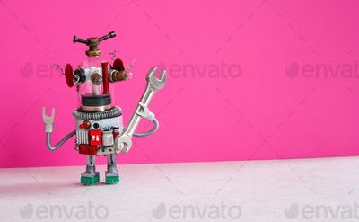 Toy robot mechanic holding a wrench tool in his hand.