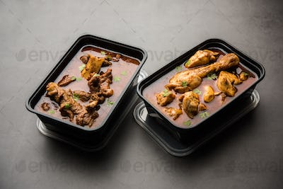 Online food delivery - mutton and chicken curry in plastic container