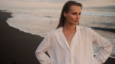 Beautiful girl resting by the ocean. Gorgeous model posing on paradise island
