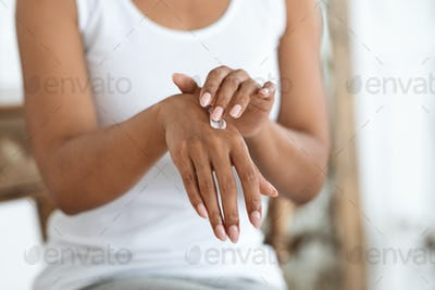 Recovery Hand Cream. African American Woman Applying Rich Lotion On Her Skin