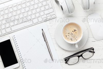 Workplace with computer, smartphone and coffee