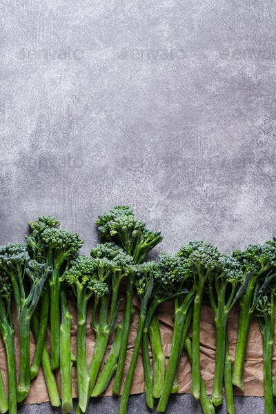 Row of Broccolini on Stone Background.