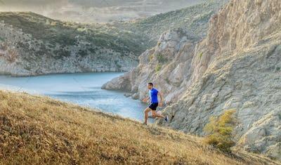 man athlete running uphill