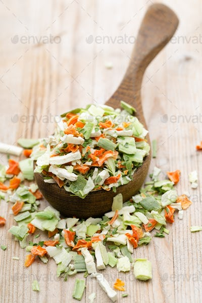 Dried vegetable spice. Bio herbs product. Finely chopped herbs.