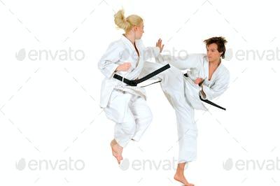 Young karateka couple in a kimono suit