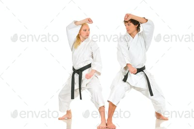 Strong blonde girl and the impudent karate guy