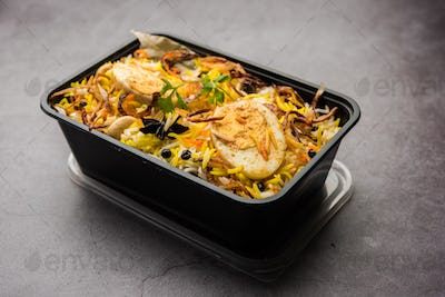Online Food Delivery - Anda Pulao Or Egg Biryani packed in Plastic box