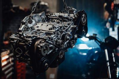 Suspended boxer engine in a dark garage or workshop
