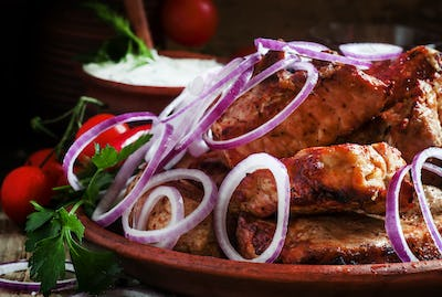Caucasian Pork shish kebab with garlic sauce and spices