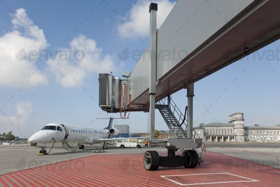 Boarding Bridge Leading to a Parked Plane